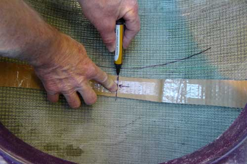 Marking the interior hull to show the centre point of the seat