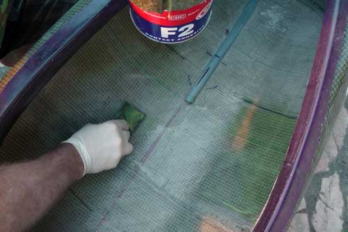 Applying contact adhesive to the interior hull